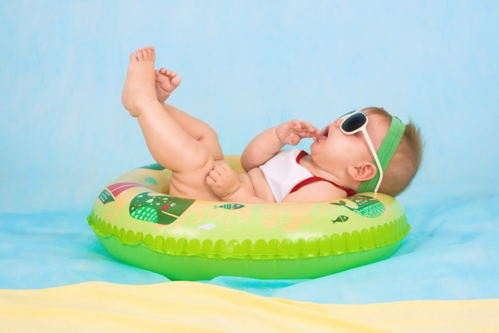 A baby in a swimming pool